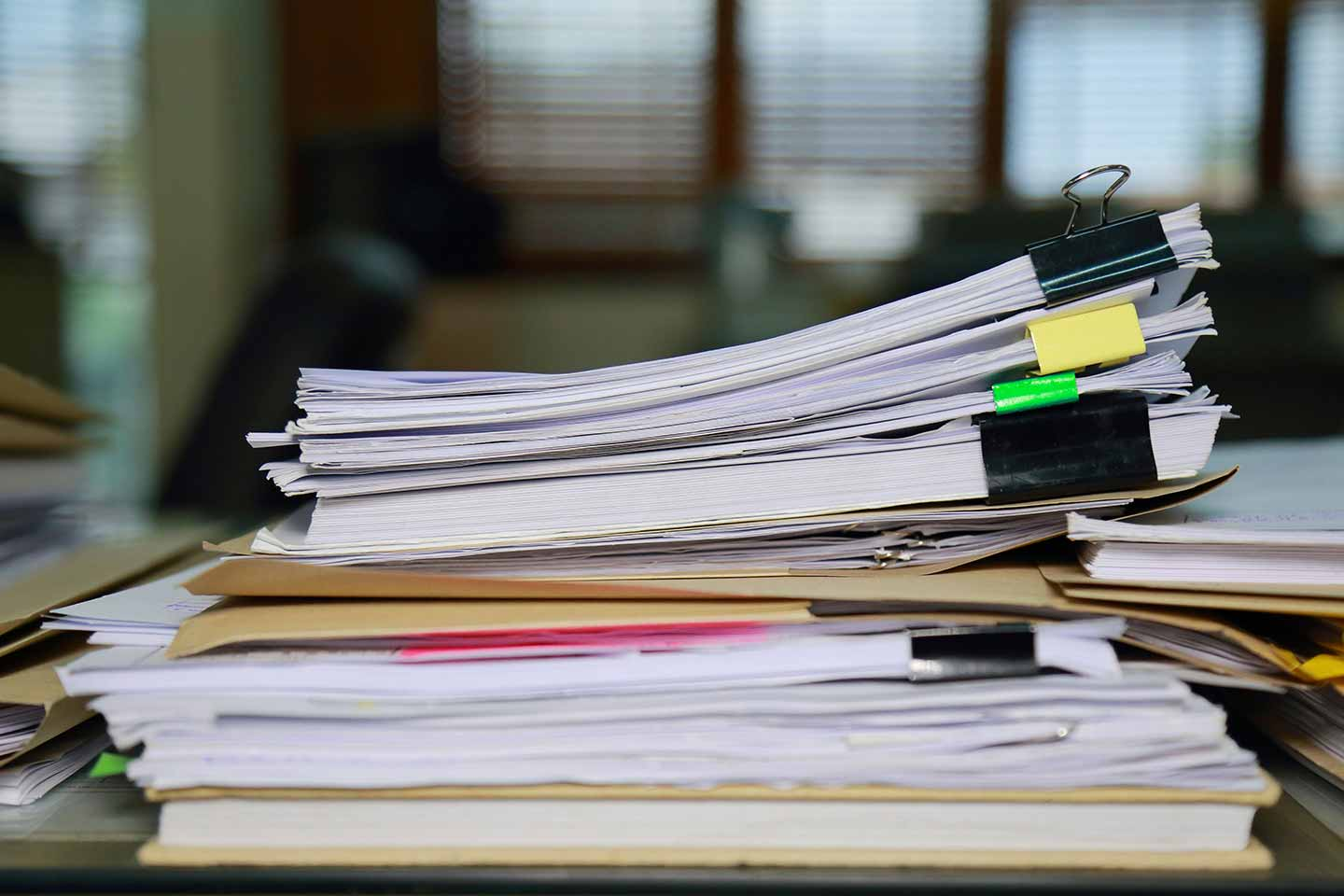 Stack of tax documents on desk.
