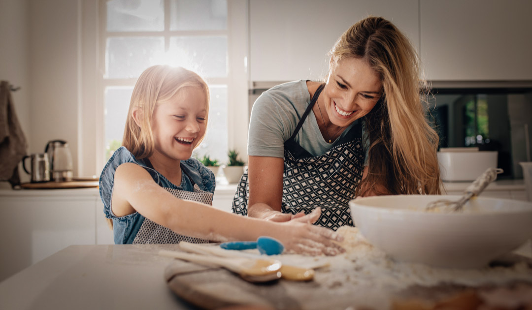 Mother with daughter baking